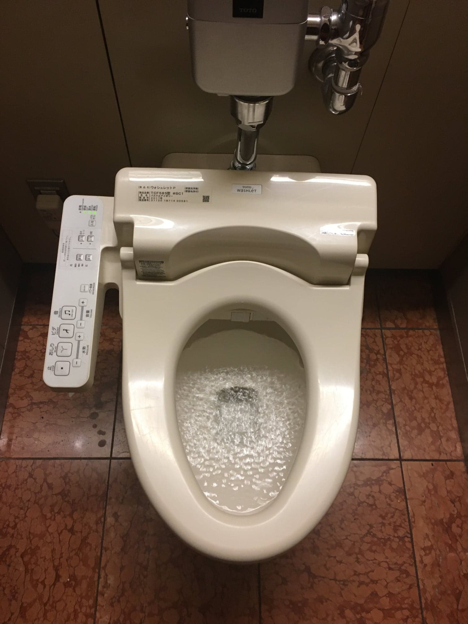 Japanese toilet at the underground station.