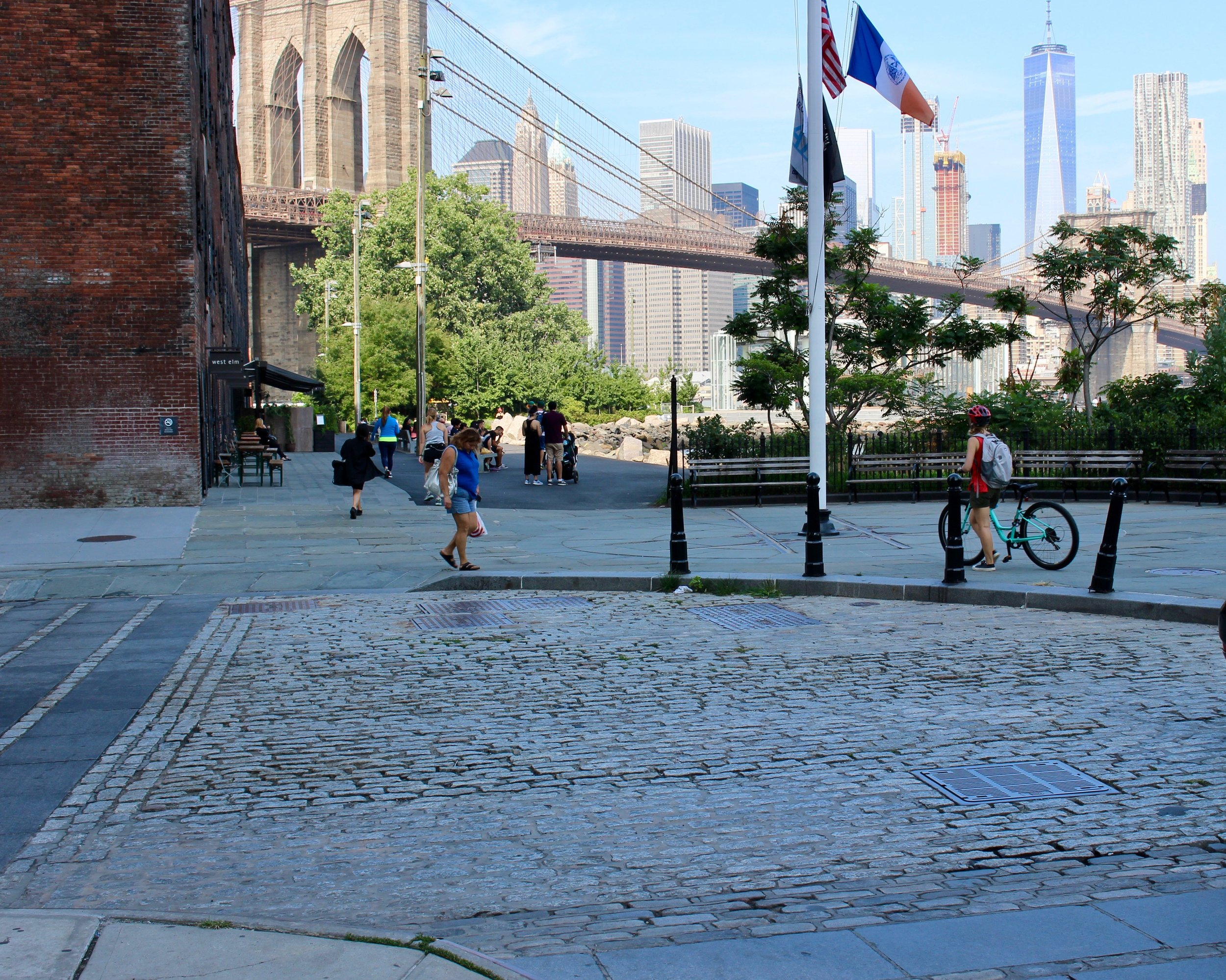 The view from the cobblestone cul-de-sac at Main Street. It's a beautiful, serene spot, where you can continue through Brooklyn Bridge Park. This view is looking south. Note the Brooklyn Bridge and downtown NYC in all its glory. We're going to step out of the Park onto Main Street here to finish up our morning walk.
