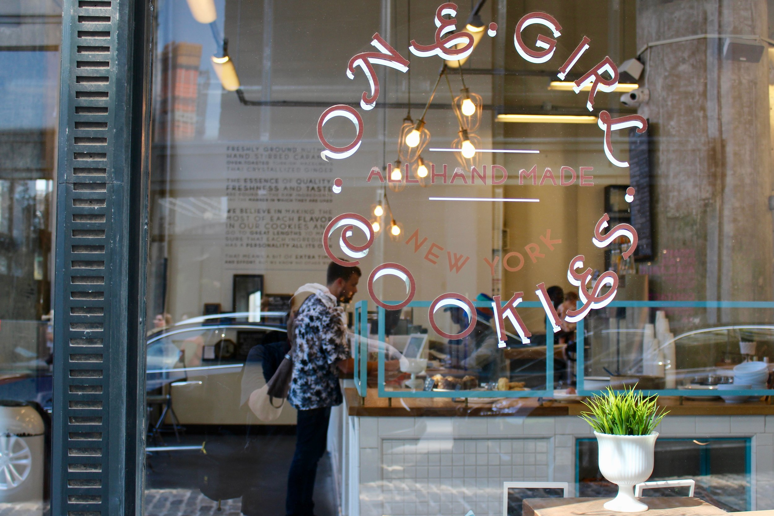 Through the window at One Girl Cookies, Water Street side.