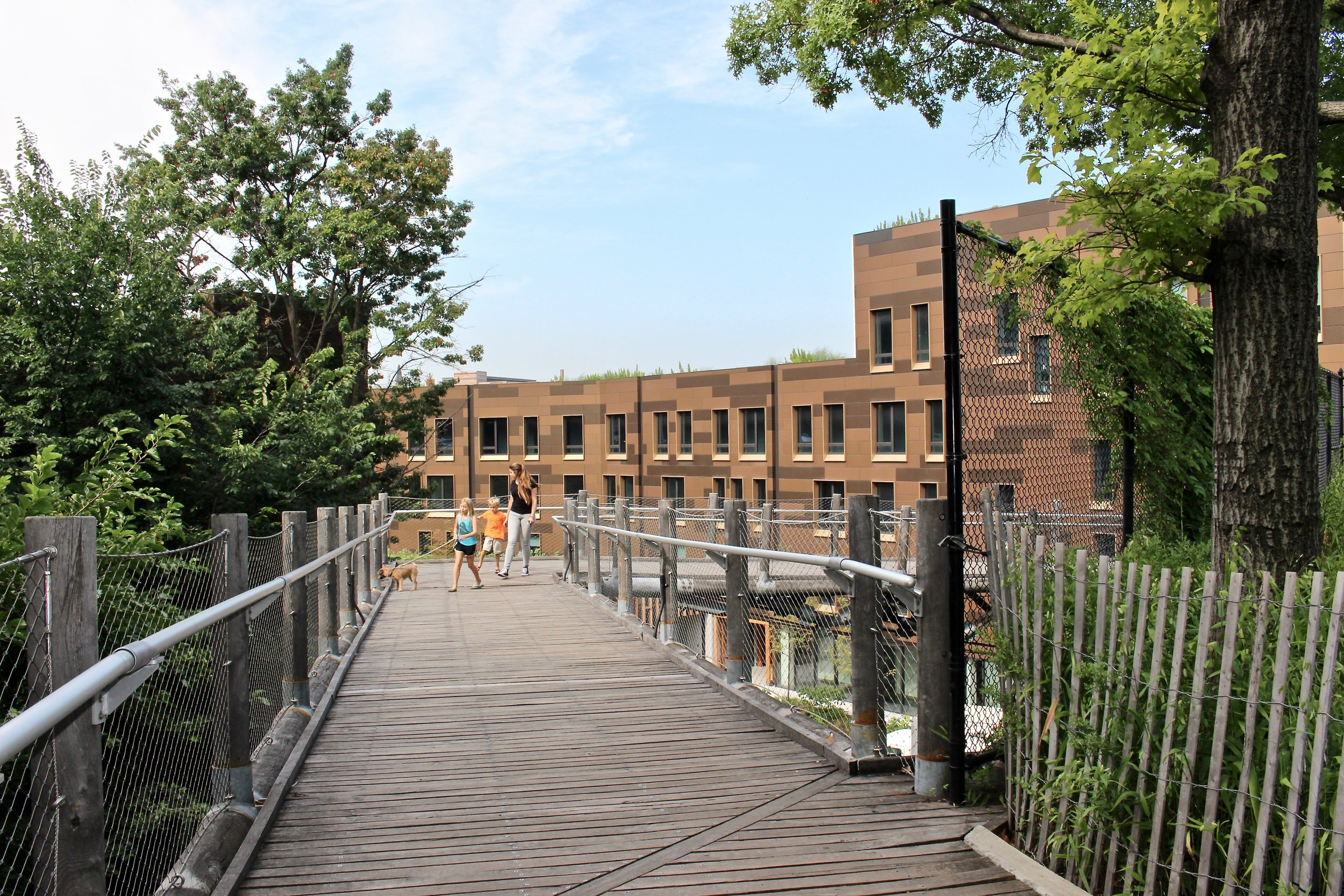 """Another """"leg"""" of the zig zag across and as you can see downhill. The Pier House is the building you can see, which is located on the other side of the BQE on the waterfront, overlooking Brooklyn Bridge Park."""