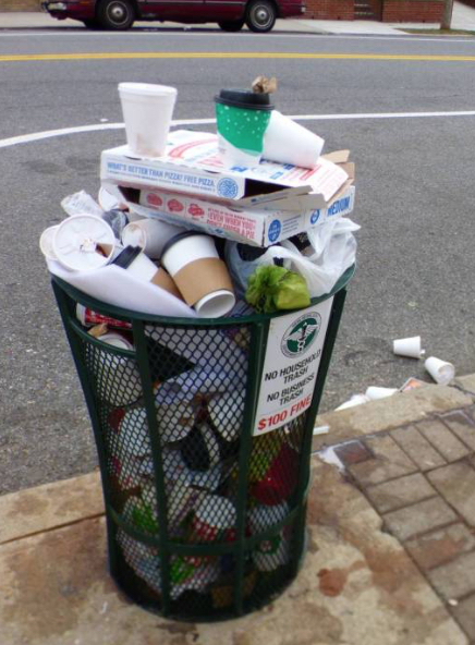 Overflowing New York City trashcan
