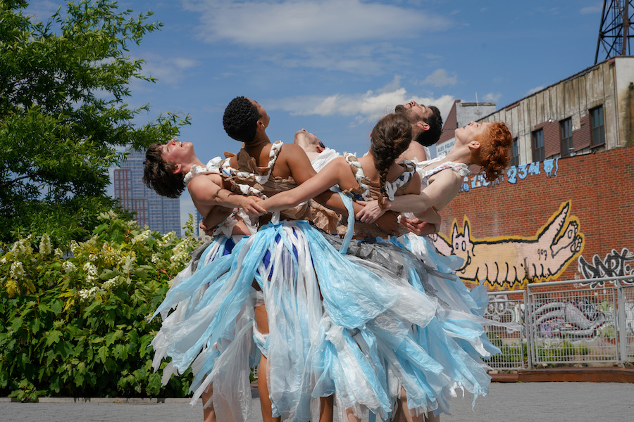 """While the world is drowning in plastic, Neuman's troupe is dancing in it as a way to get people to really see the garbage they generate and discard and understand the damage it causes to the environment."" -"