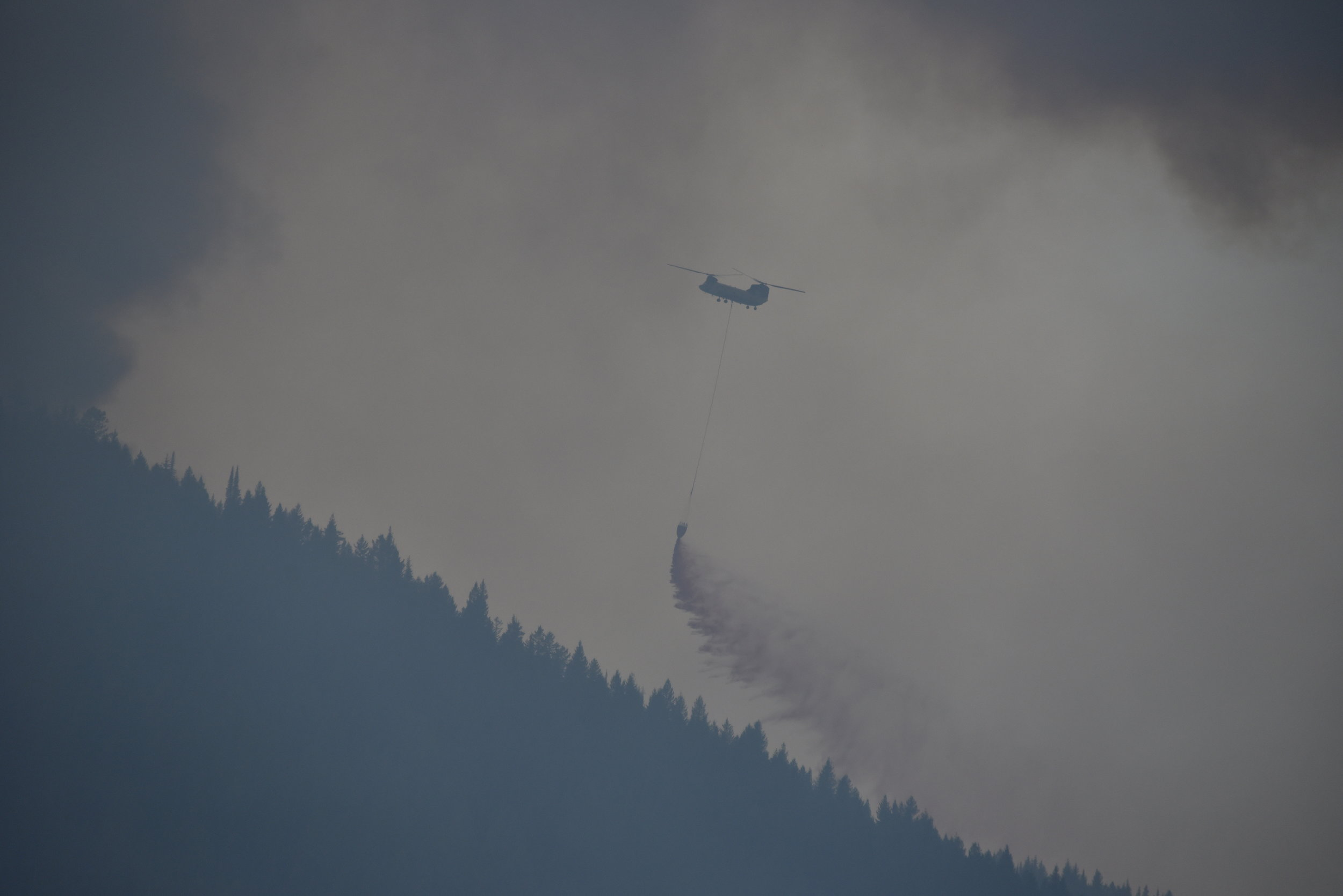 Firefighters near Essex, MT, just south of the park.