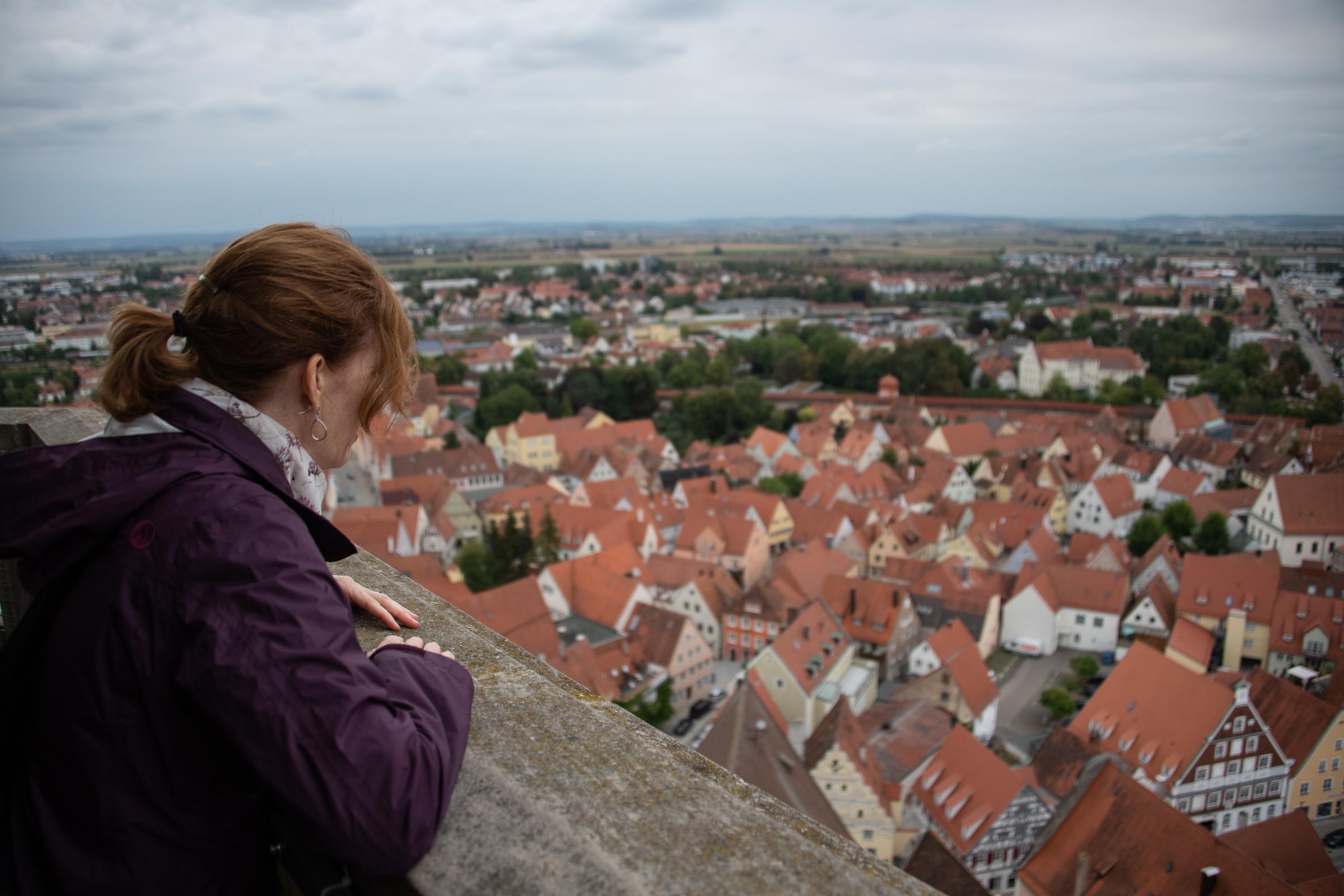 Melissa peering over the steeple ledge
