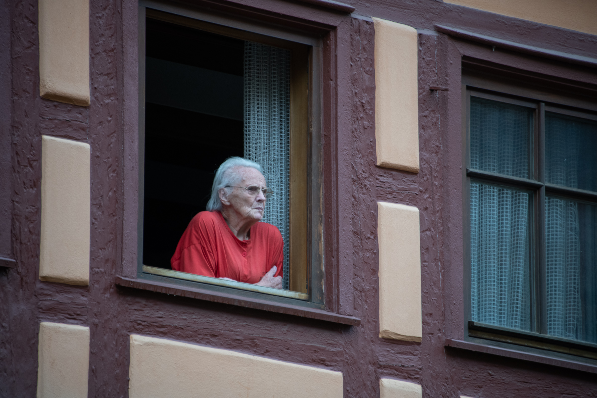 Like the watchtowers of old, this lady sat in her window watching the tourists