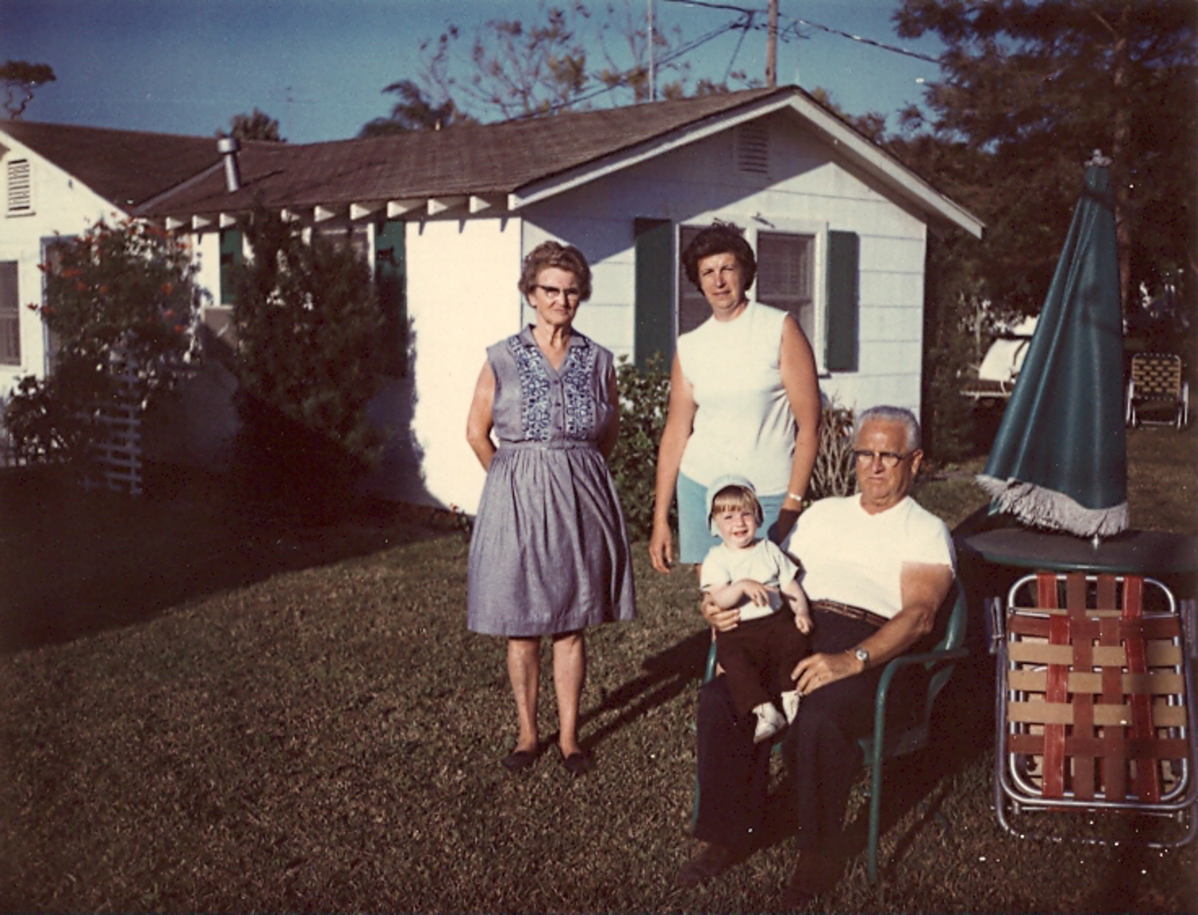 My Grandma Krull, mom and me on Grandpa Krull's lap. He died in May of that year.
