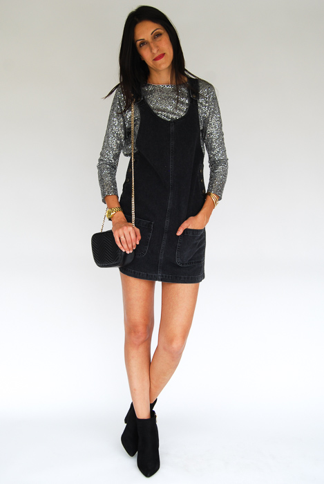 - Black romper + sparkly pullover + black ankle boots + black crossbody