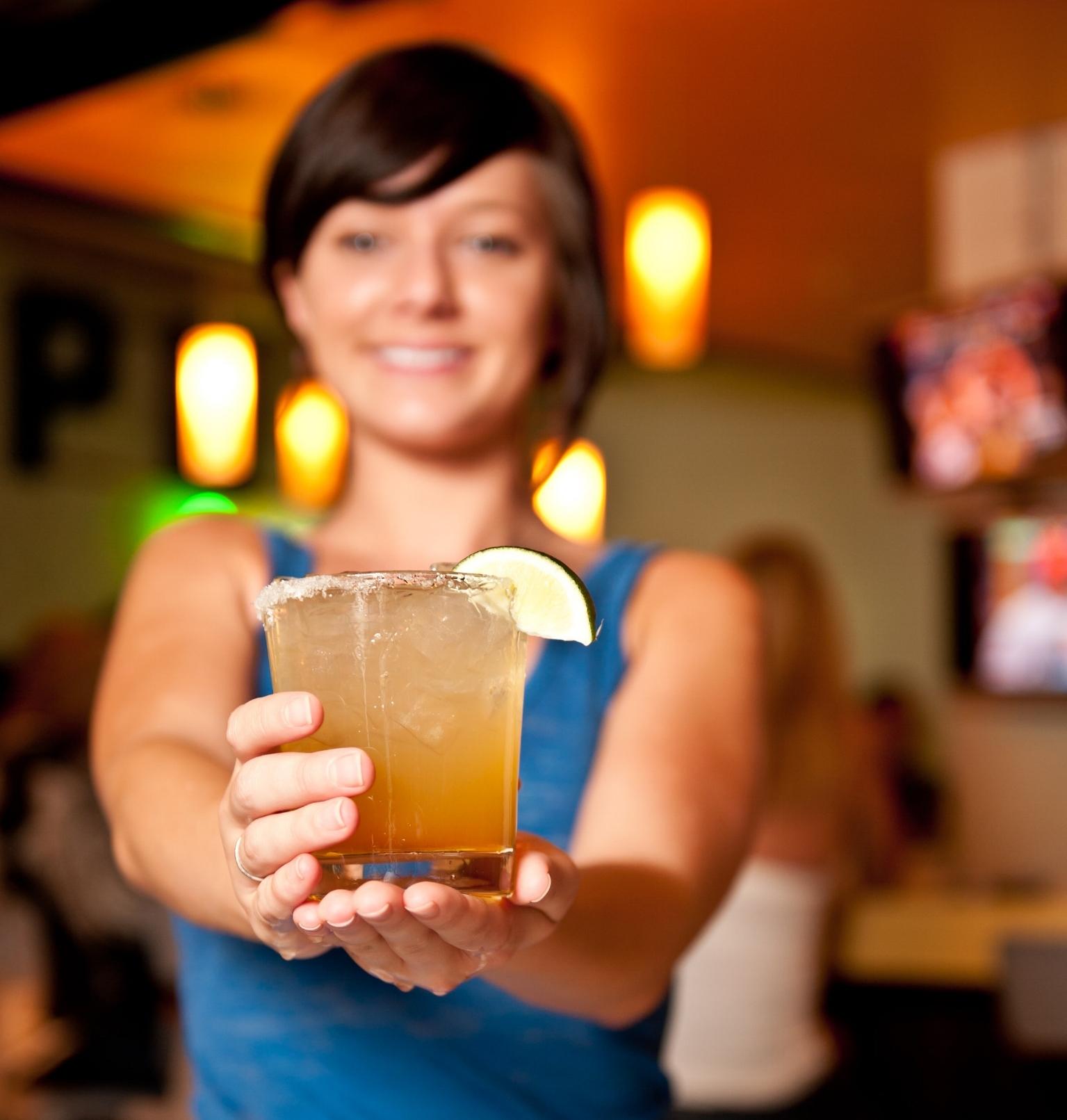 Vibe_Alpharetta_Server holding a margarita.jpg