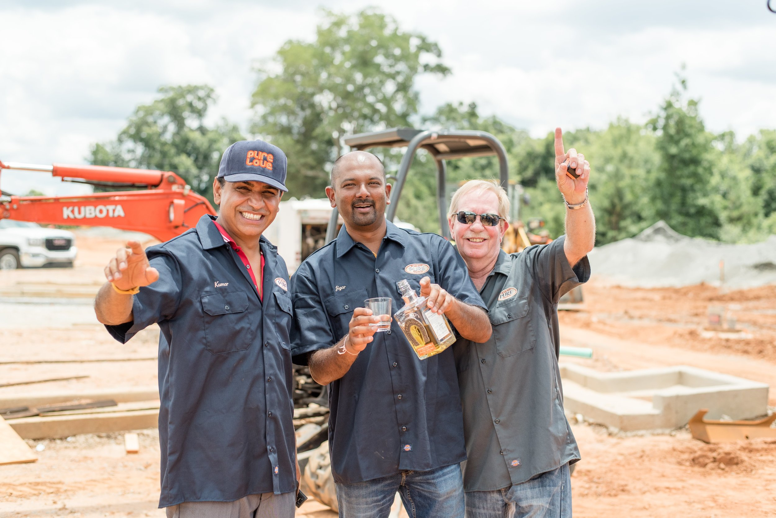 Pictured : Franchisees Suresh Kumar (left) , Jigar Shah (middle), and manager Dennis Butterfield (right)