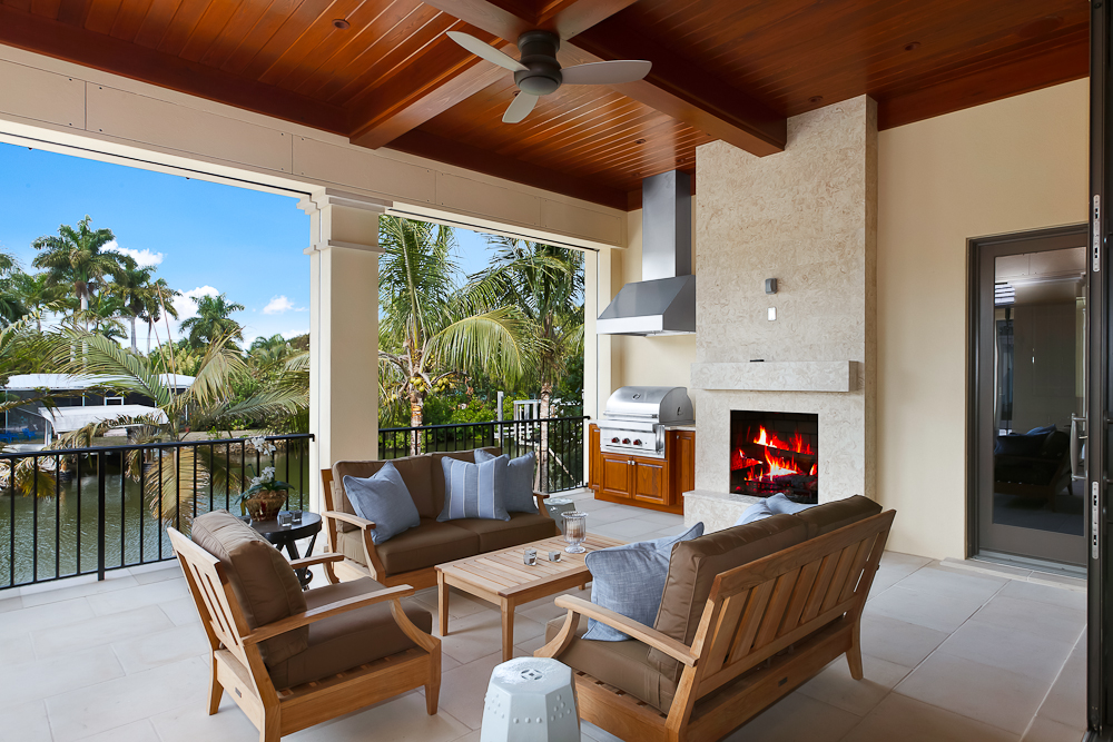 11 - Naples Boater's Dream - Canal-Side Lanai with Outdoor Kitchen, Fireplace, Pool Bath.jpg