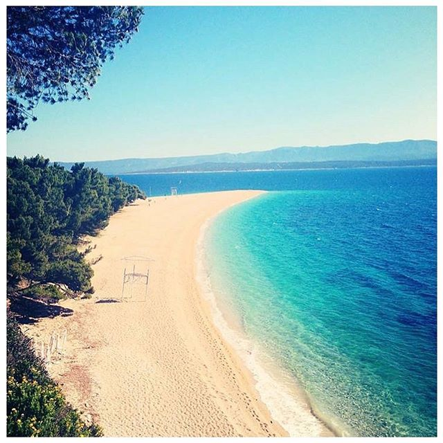 """A LIST OF THE BEST BEACHES IN CROATIA! - Firstly, the one thing you should know is most Croatian beaches, while beautiful, aren't sandy, but rather, made of rock. It can definitely be uncomfortable on your feet so make sure you have good sandals! So, which to visit?! ___ ZLATNI RAT, BRAC (pictured) Wow, so this was hands down one of the most beautiful beaches we have come across, anywhere. And several publications like Nat Geo and the NYT have referenced it as one of the best in the world. . It's referred to as the Golden Horn, as the tiny rocks stretch out 2,000 feet into the ocean and actually spiral at the very end. Go to Google Images to see this beach from an aerial view. It's insane! To get there, take a ferry to Brac from Split, and then take a cab from there! ___ BANJE BEACH, DUBROVNIK For both a beautiful beach sitting on turquoise water, and an excellent view and Instagrammable opportunity of the walled city of Dubrovnik, head to this beach right outside of town! ___ STIVINA BEACH, VIS Vis's Stivina Beach is a hidden cove you'll need a private boat to visit! It's picturesque and you enter from a """"cliff gate"""" that makes for the most amazing setting...more on this spot later! ___ PUNTA RATA, BRELA You can find this beach right off of the main coastal highway about an hour north of Split - you're just going to have to hike down to get there as the dramatic mountain range drops suddenly in this part of the Dalmatia coast. And this beach area is famous for its rock formation that sticks out from the beach! ___ NUGAL BEACH, MAKARSKA Surrounded by tall cliffs, this beach is breathtaking. Fair warning, it's also a nudist beach, but definitely the most beautiful in the area, so worth the view (pun intended 😉) ___ MALI BOK BEACH, CRES ISLAND Hard to get to (you must hike so wear good shoes to get there) but rewarding once there. This also is a secret cove beach that will not disappoint."""
