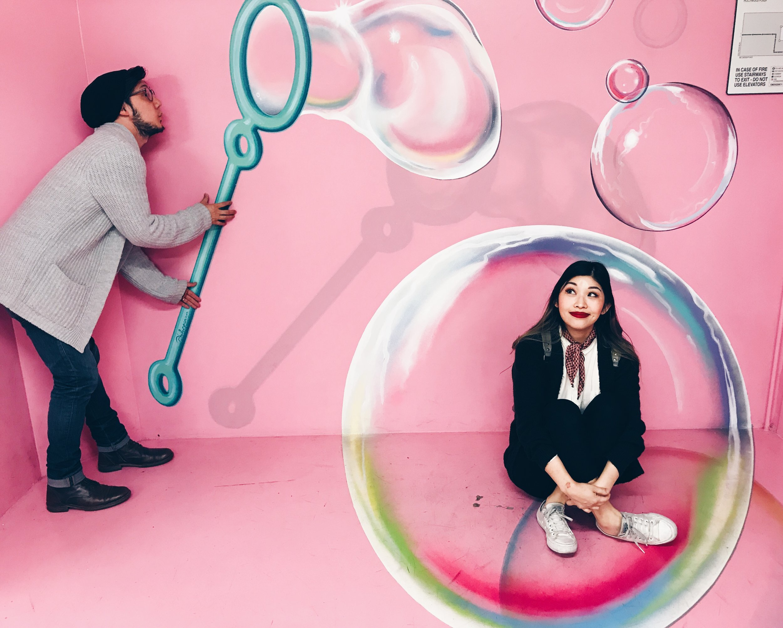 Museum of Illusions Los Angeles Bubble Blowing Pink Wall