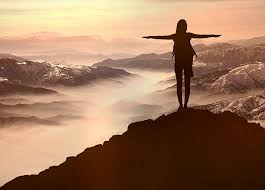 Brave woman on mountaintop.jpg