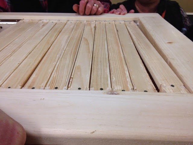 """Liedlich modified some standard Lang frames to sit side by side and make a """"ceiling"""" for the bees."""