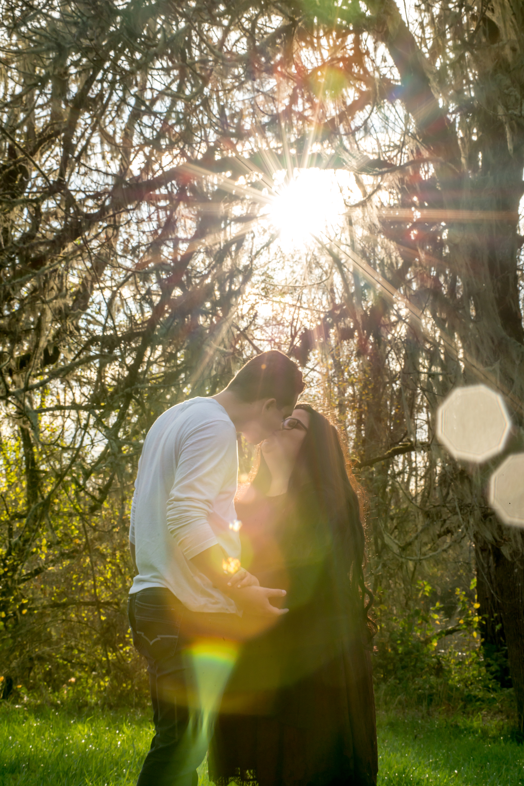 Wes Fisher Photography - Engagement - couple with light flare.jpg