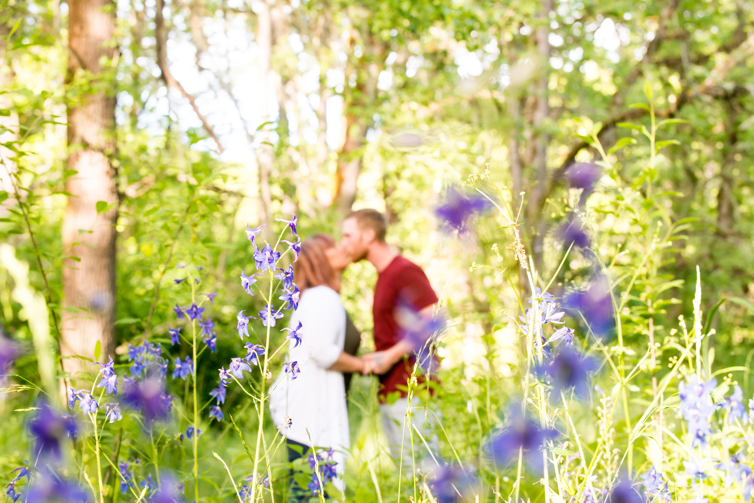 Wes Fisher Photography - Engagement - kissing out of focus.jpg