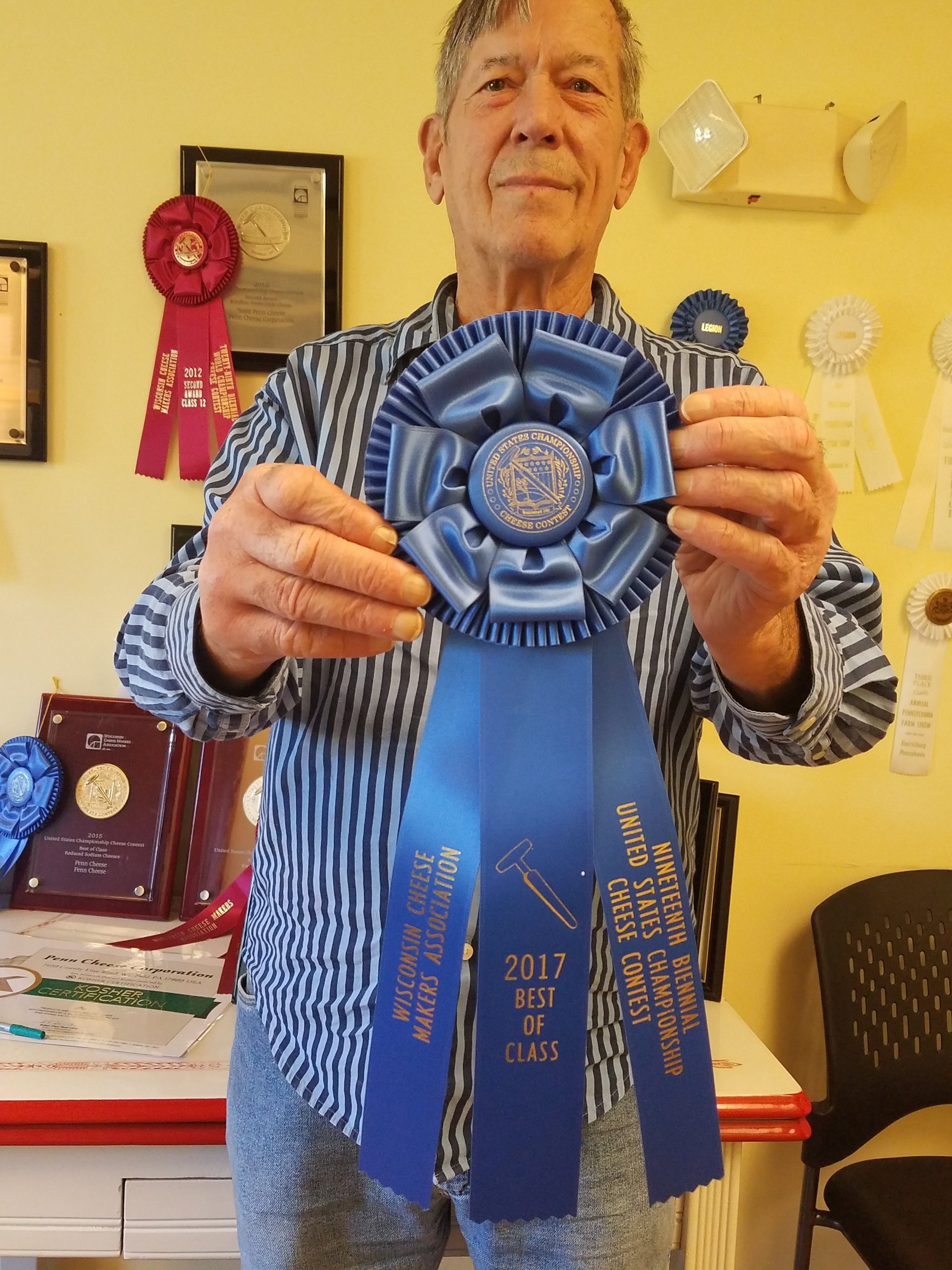 Marlin with one of his many National and International awards for his cheese.