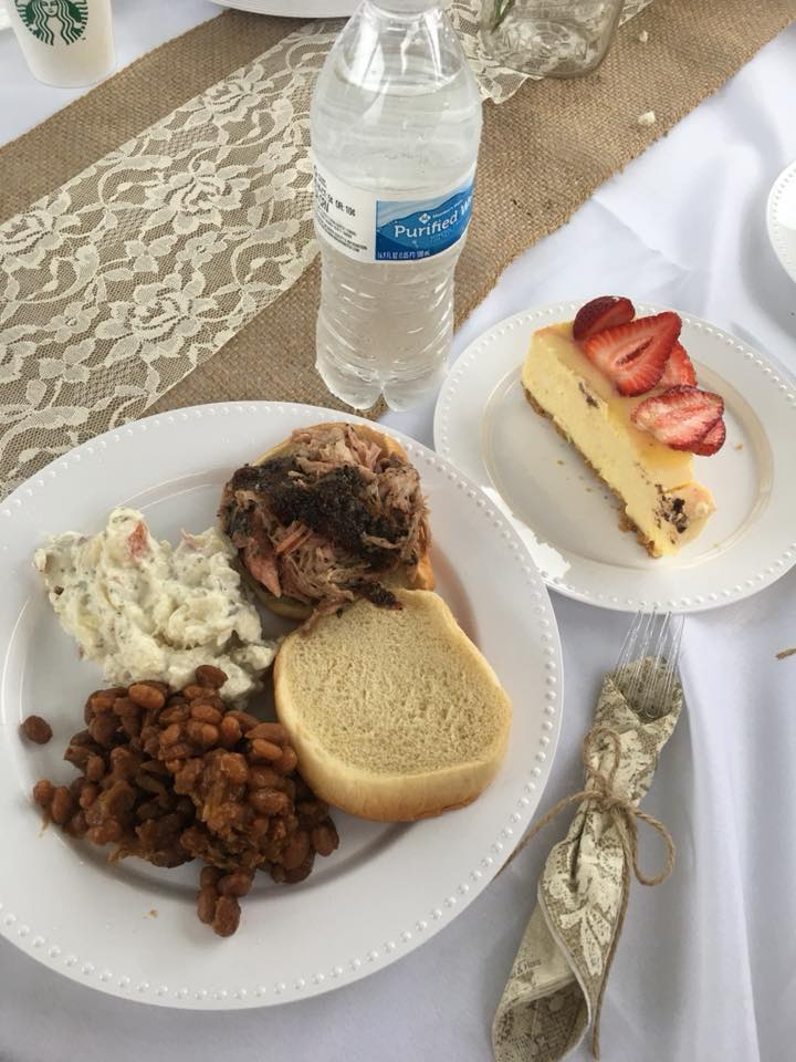 Pictured Above: Pulled Pork Sandwich, Baked Beans and Potato Salad