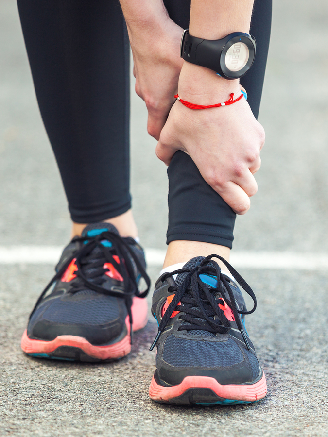 bigstock-Female-Runner-Is-Holding-Her-I-139960910.jpg