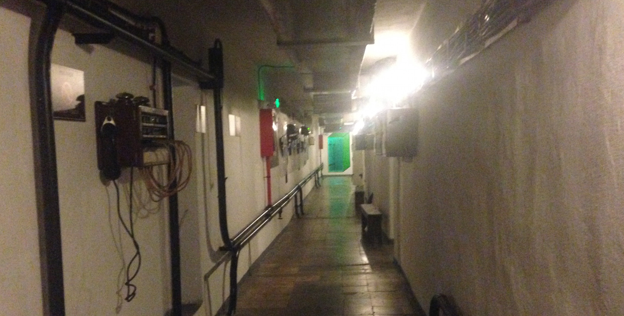 Inside BUNK'ART2 - rooms off to either side contain horrifying records of surveillance, imprisonment and interrogation . The green door at the end is the decontamination room, never used.