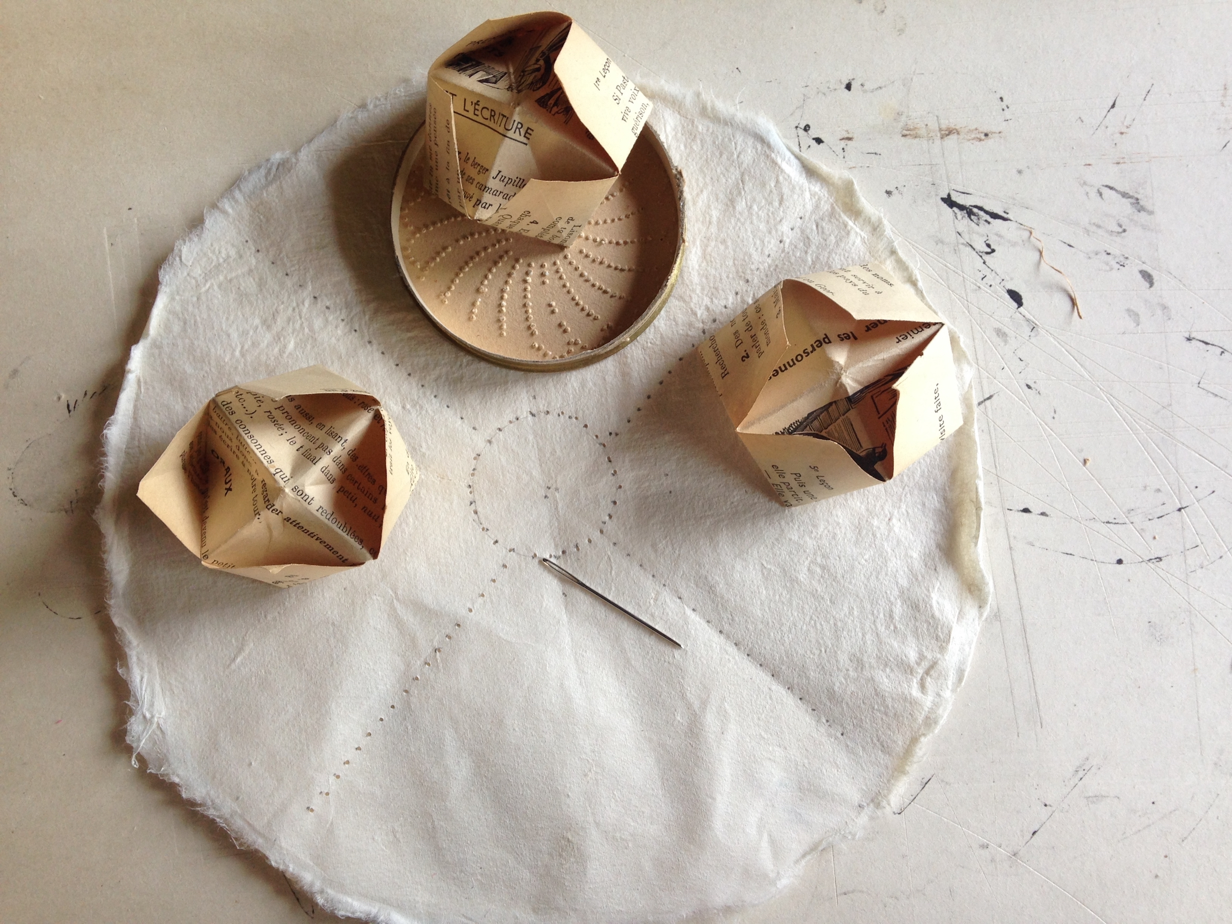 Handmade kozo paper with holes marked and paper chatterboxes