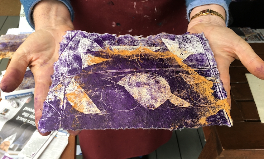 The purple ink on the rusted orange paper looked great.