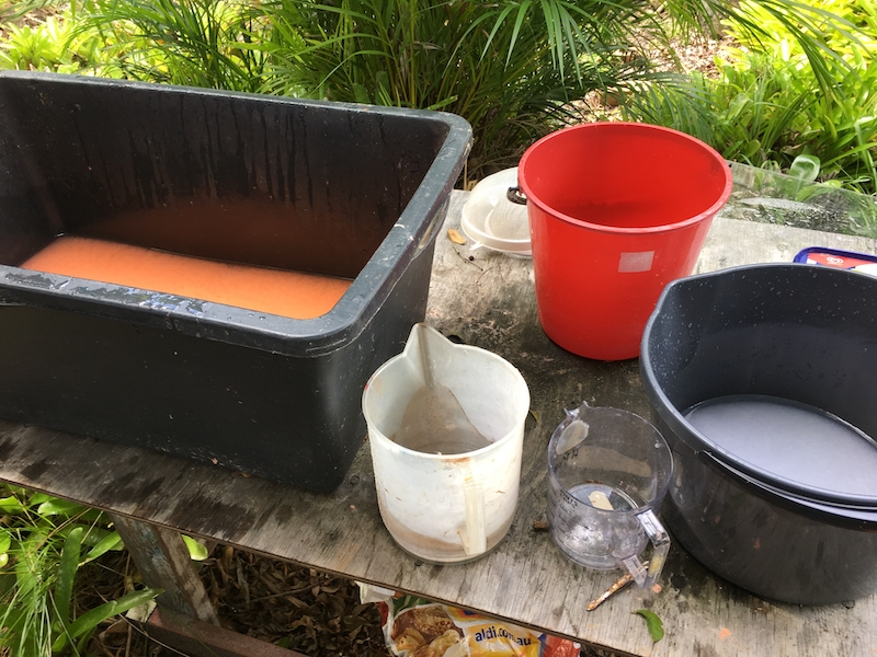 In the garden studio with paper vat, white pulp and flood mud.
