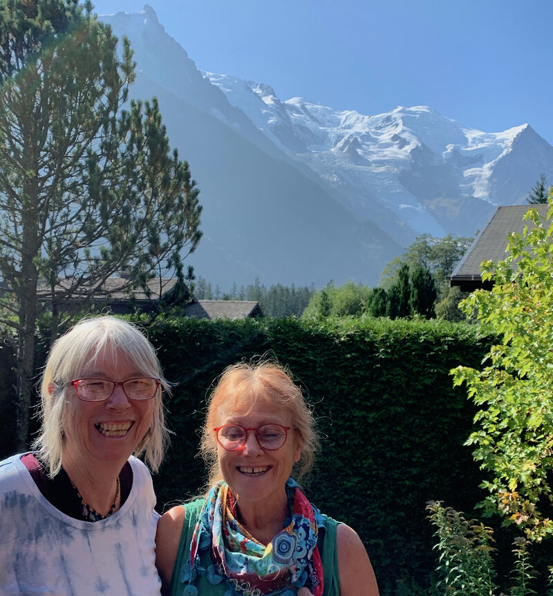 On Viviane's terrace in Chamonix with the mountains in the background.