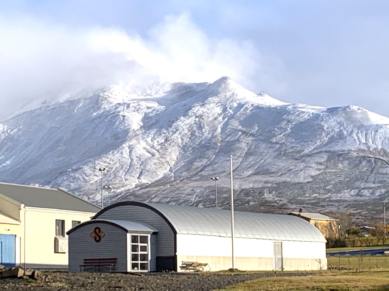 The Spákonufell museum under a snowy Mount Spákonufell, the Prophetess Mountain.