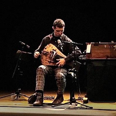 Matthias Loibner making sounds with plaid pants and astounding virtuosity.