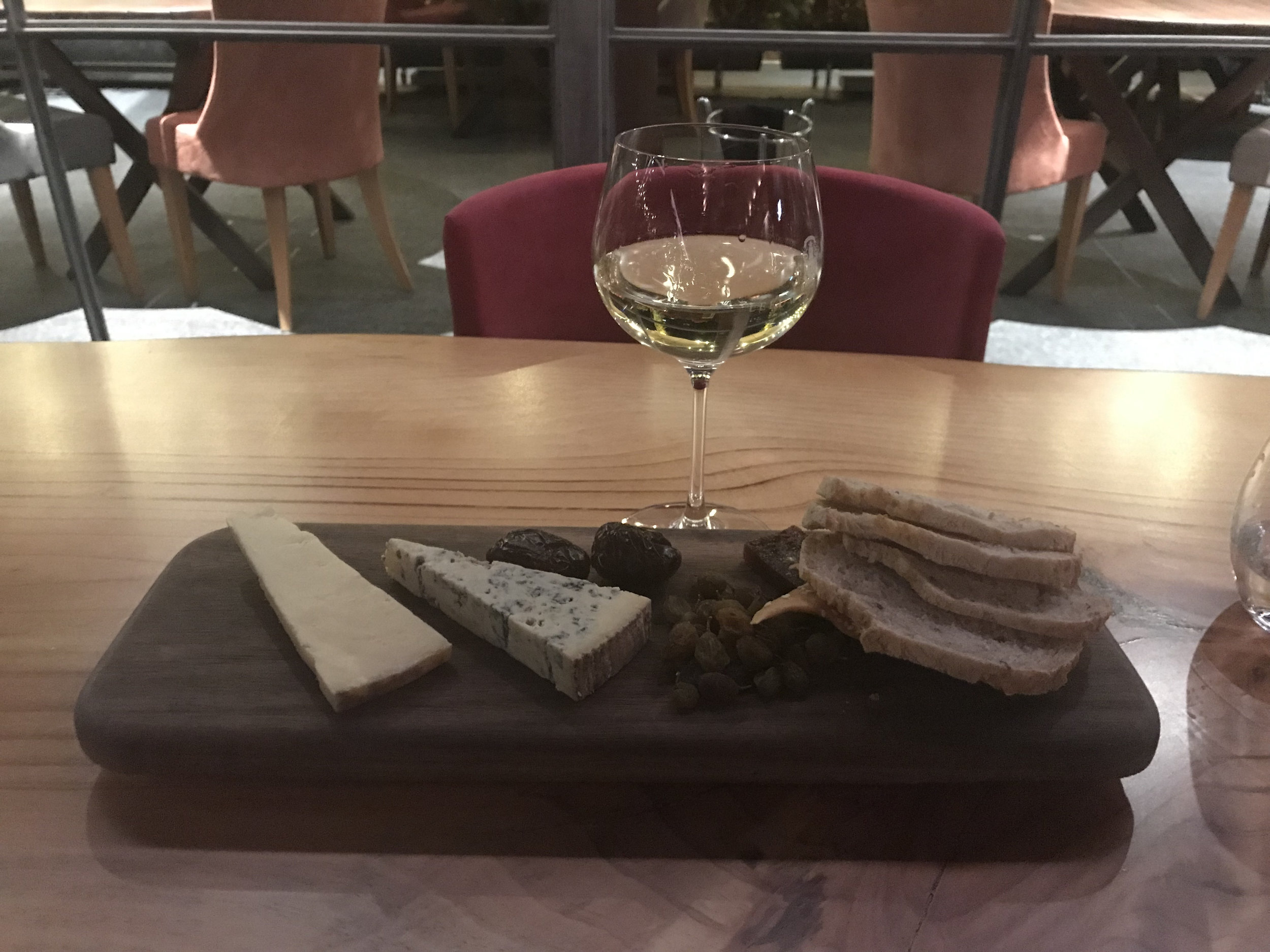 A cheese plate with Chardonnay.