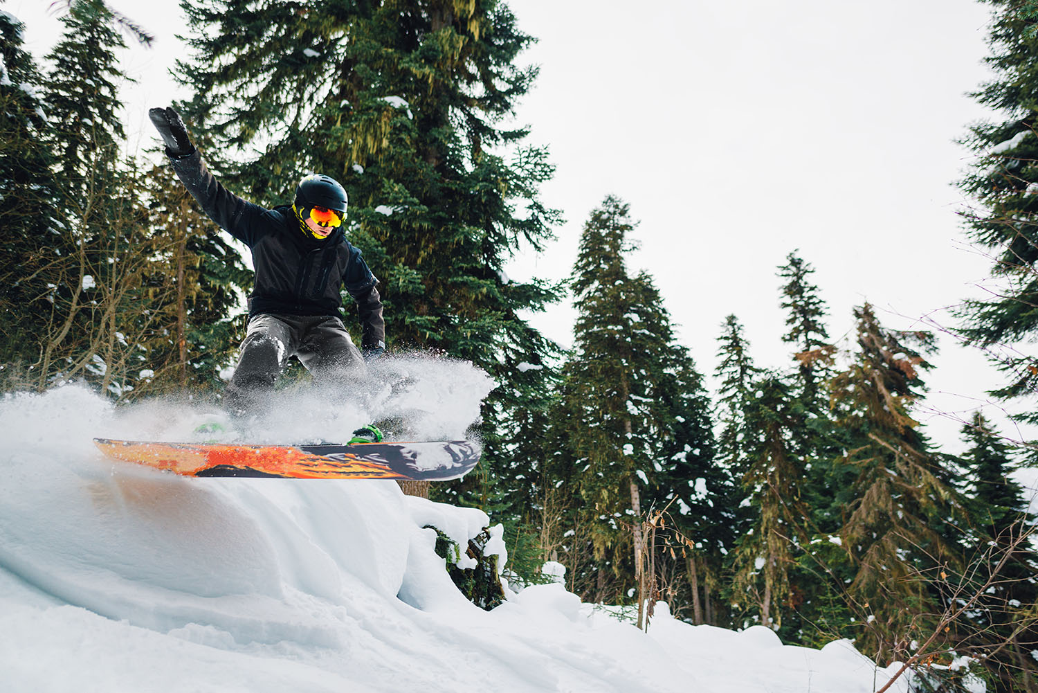 snowboarder is jumping in the mountain forest