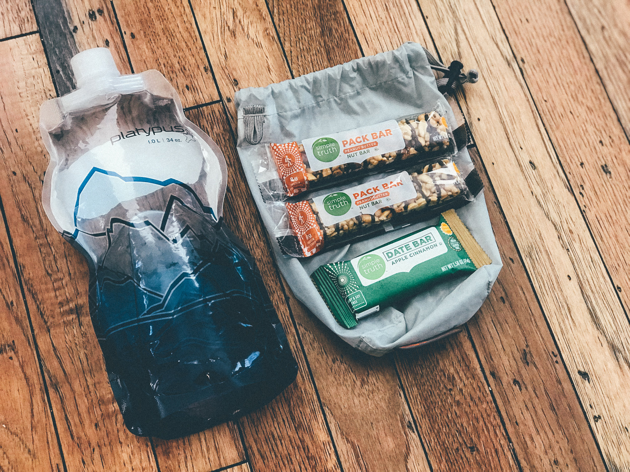 Food and Water - Bring what you like and what keeps you going.A little extra is a good thing. Everyone is a bit different here.I generally carry Bars, PB&J and approximately one litre of water