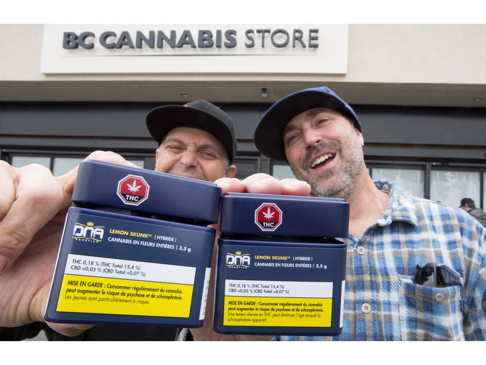 Don and Aaron (last names withheld) from the United States show off their cannabis purchases outside British Columbia's first legal B.C. cannabis store in Kamloops, B.C. Wednesday, Oct. 17, 2018. Canada legalized cannabis nation wide today. JONATHAN HAYWARD / THE CANADIAN PRESS