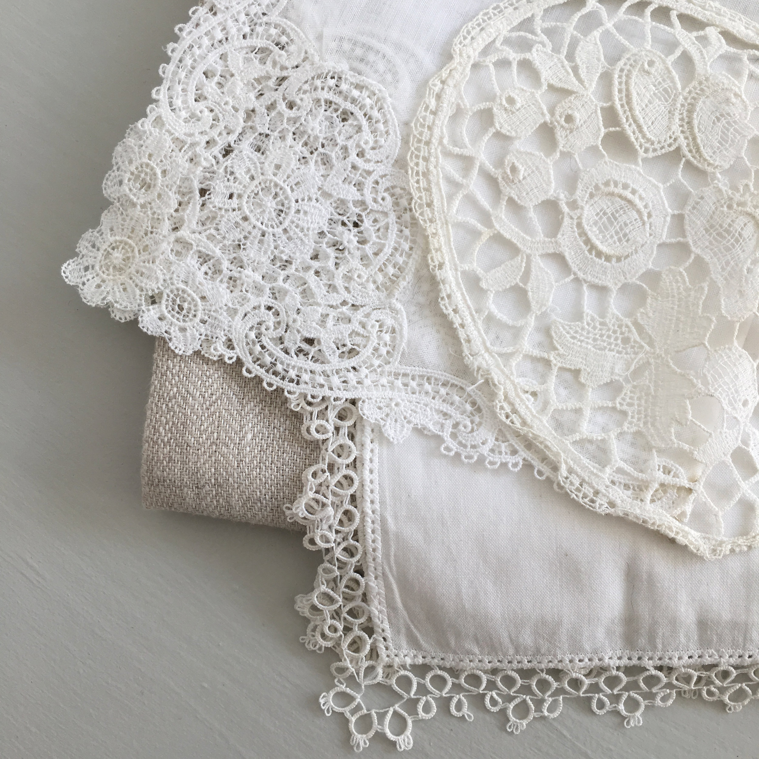 I will stop for any pile of French handwoven linens and antique lace. I know there will be a project one day for each and every found textile.