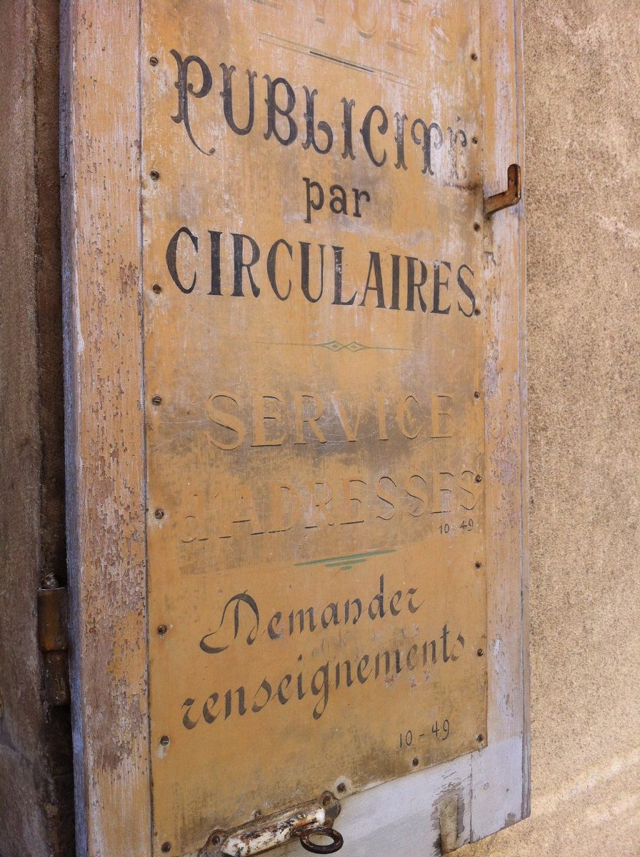 In addition to their many purposes, shutters were also used for advertising. This set can be found in the beautiful town of Beaune in Burgundy. They have been left to age gracefully.