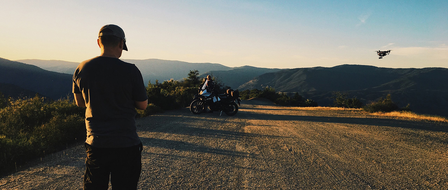 Drone capturing the final shot of the film as the sun sets over the mountains