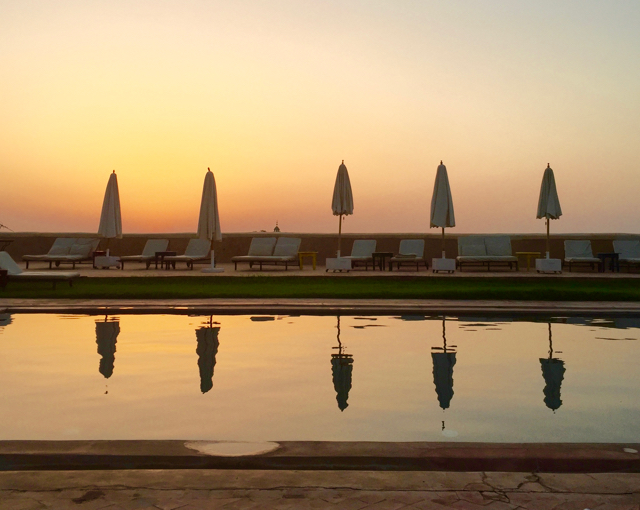 Yoga Explorers yoga retreat Marrakech. Sunset over the pool.
