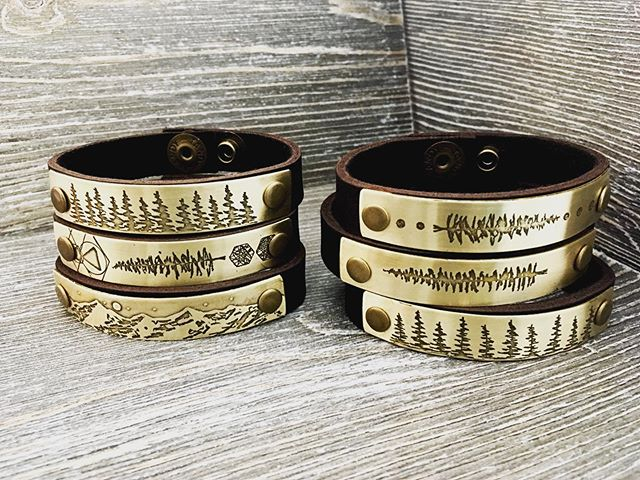 New thick leather bracelet with Mountains, trees, forests, and simple geometric designs. 🌲🏔🌲🏔🌲🏔🌲 Testing out these designs on uncoated brass to allow for a natural patina.  All will come with a polishing pad to control the finished patina.  Find them this weekend @portlandsaturdaymarket  Saturday 10-5pm space 705 & @hawthornestreetfair  Sunday, August 25th  11-6pm between SE 32nd & 33rd Ave on Hawthorne Blvd. ☀️🌲🏔🌲🏔🌲☀️ #mthood #trees #pacificnorthwest #portlandsaturdaymarket #madeinoregon #hawthornestreetfair #bohostyle #brassandleather #portland #pakhyegoods #bracelets #leatherbracelet