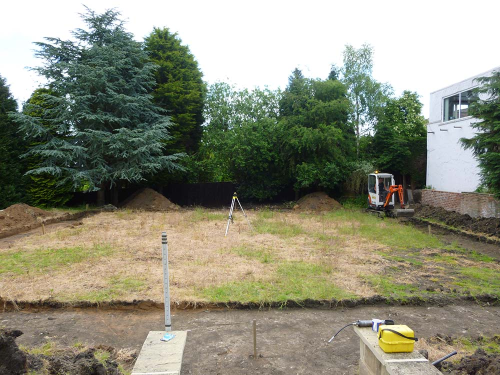 BEFORE:   Excavation works starting on the garden path. Note the stately cedar tree in the mature wooded boundary planting.