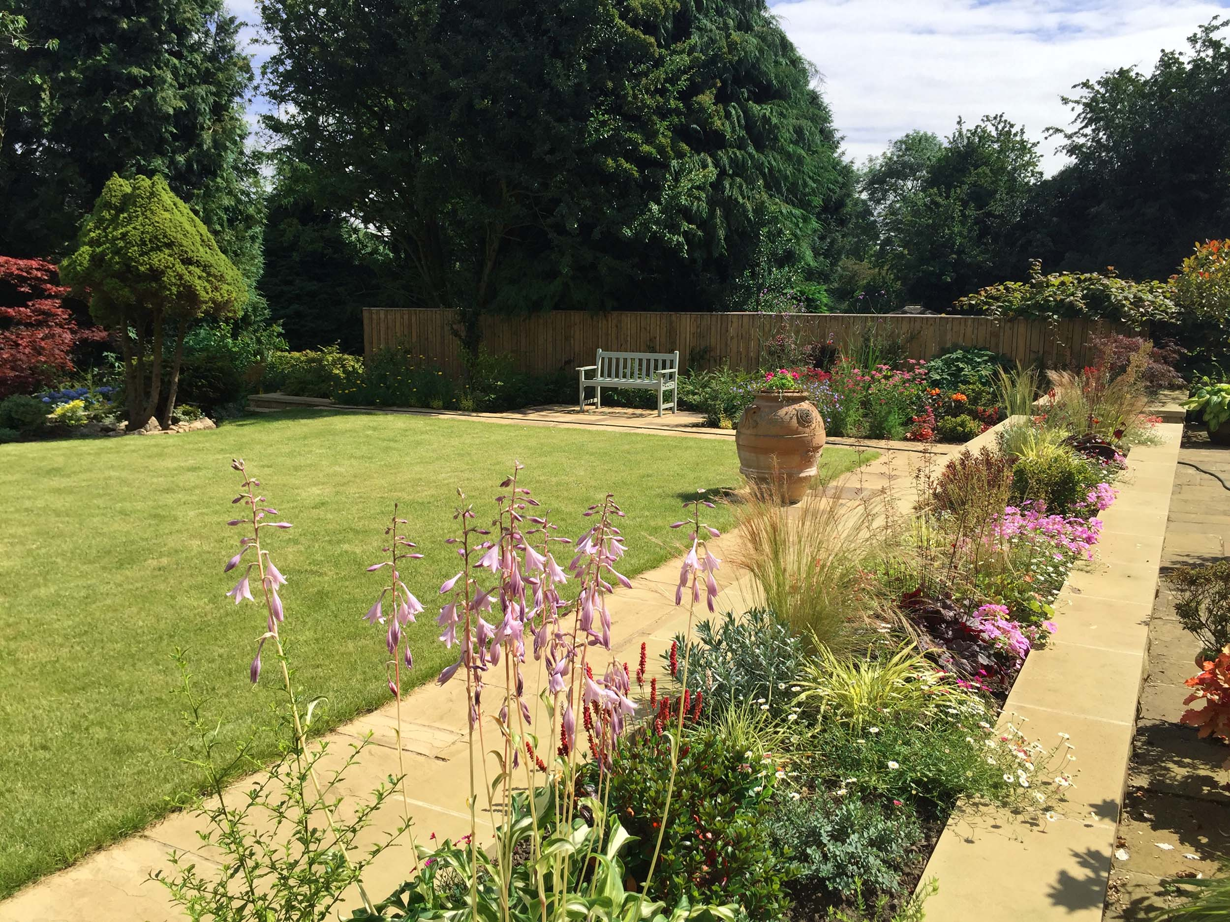 The new garden design layout includes a level lawn and all year round interest in the planting alyout