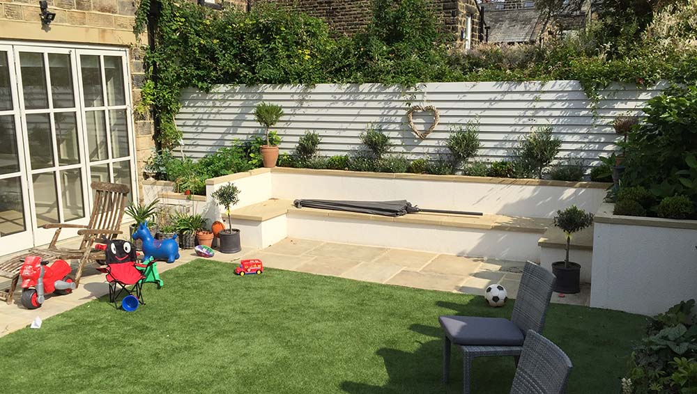 The artificial lawn and play space accessed directly from the new family kitchen/ bi-fold doors.