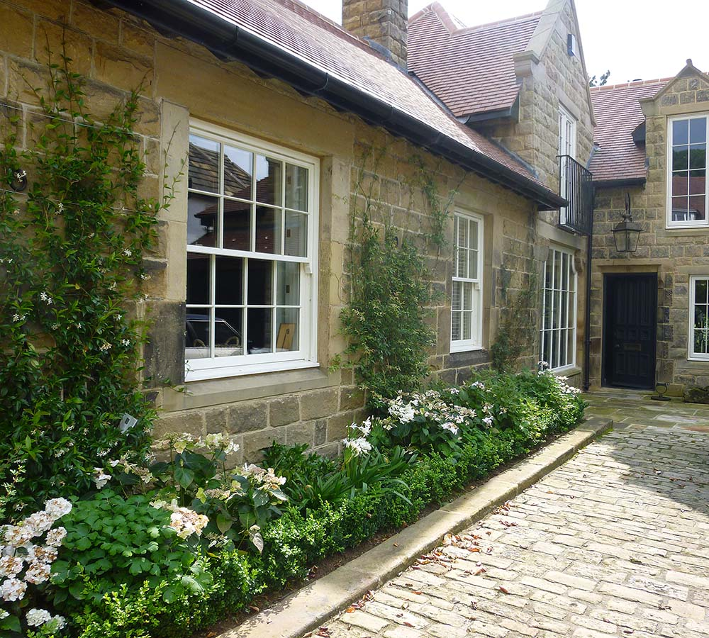 Large terraced garden and formal parking courtyard to a remodelled period house, Middleton, Ilkley.