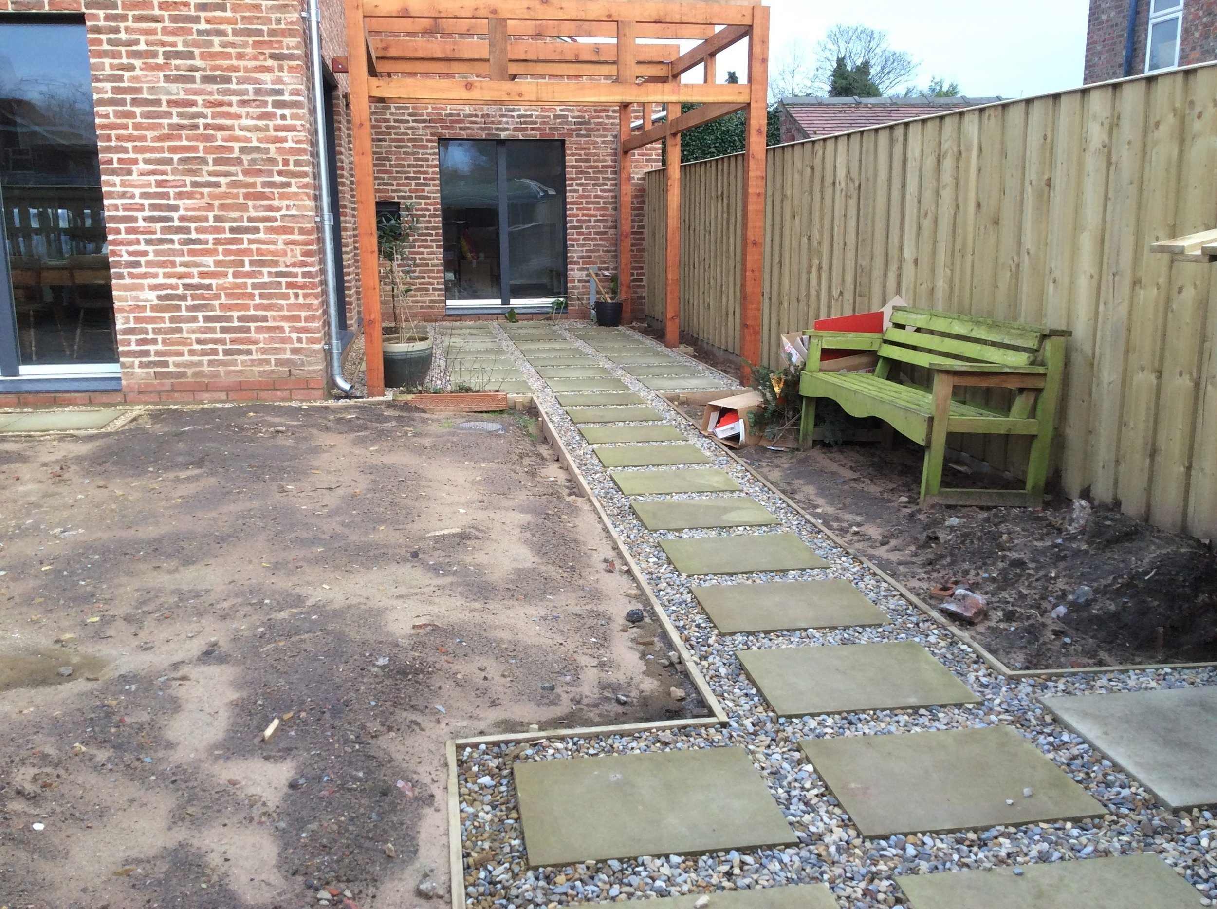 BEFORE: The front garden ready for landscaping. The builder had installed the timber pergola and main path.