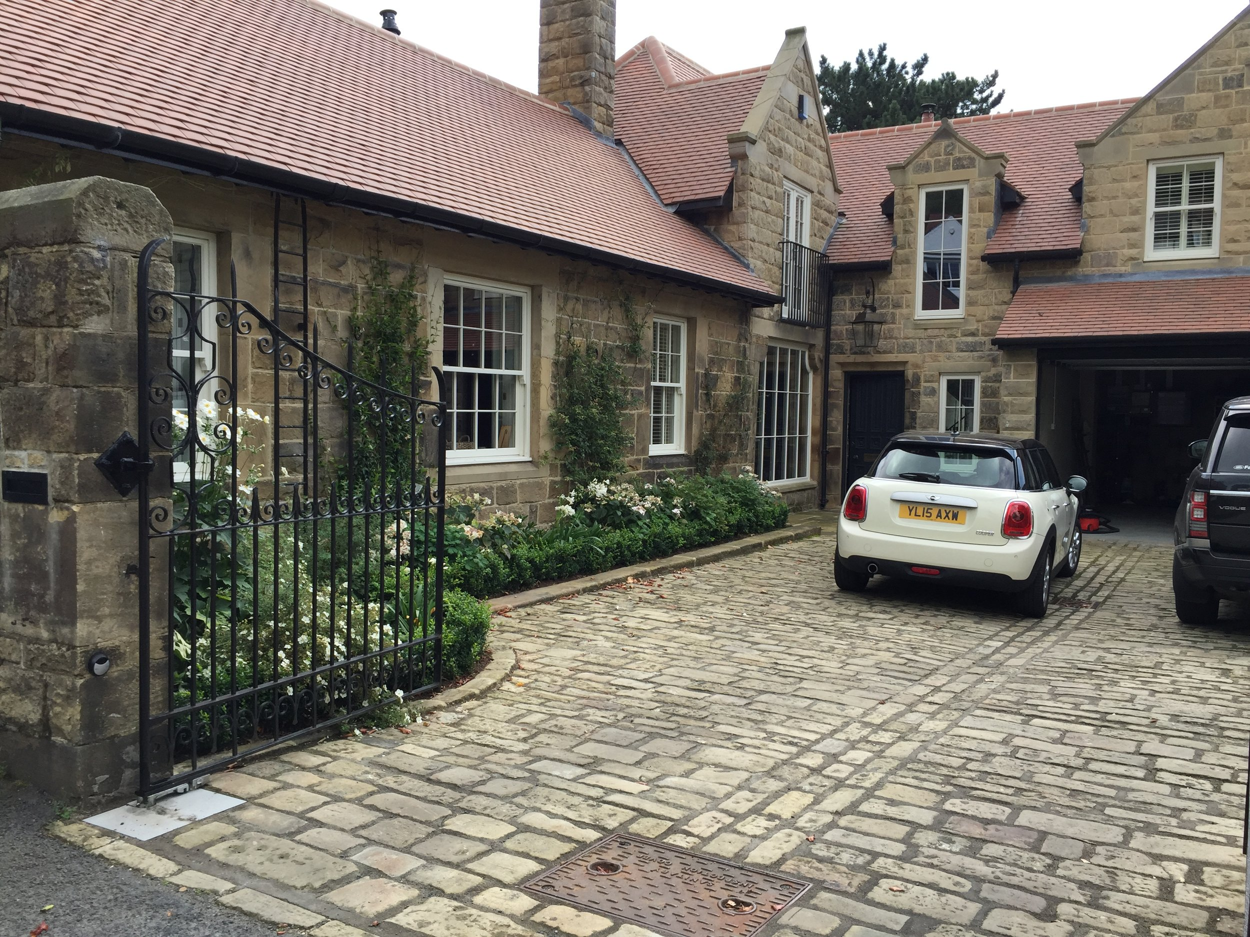 Entrance courtyard with newly laid stone setts and reclaimed stone kerb.