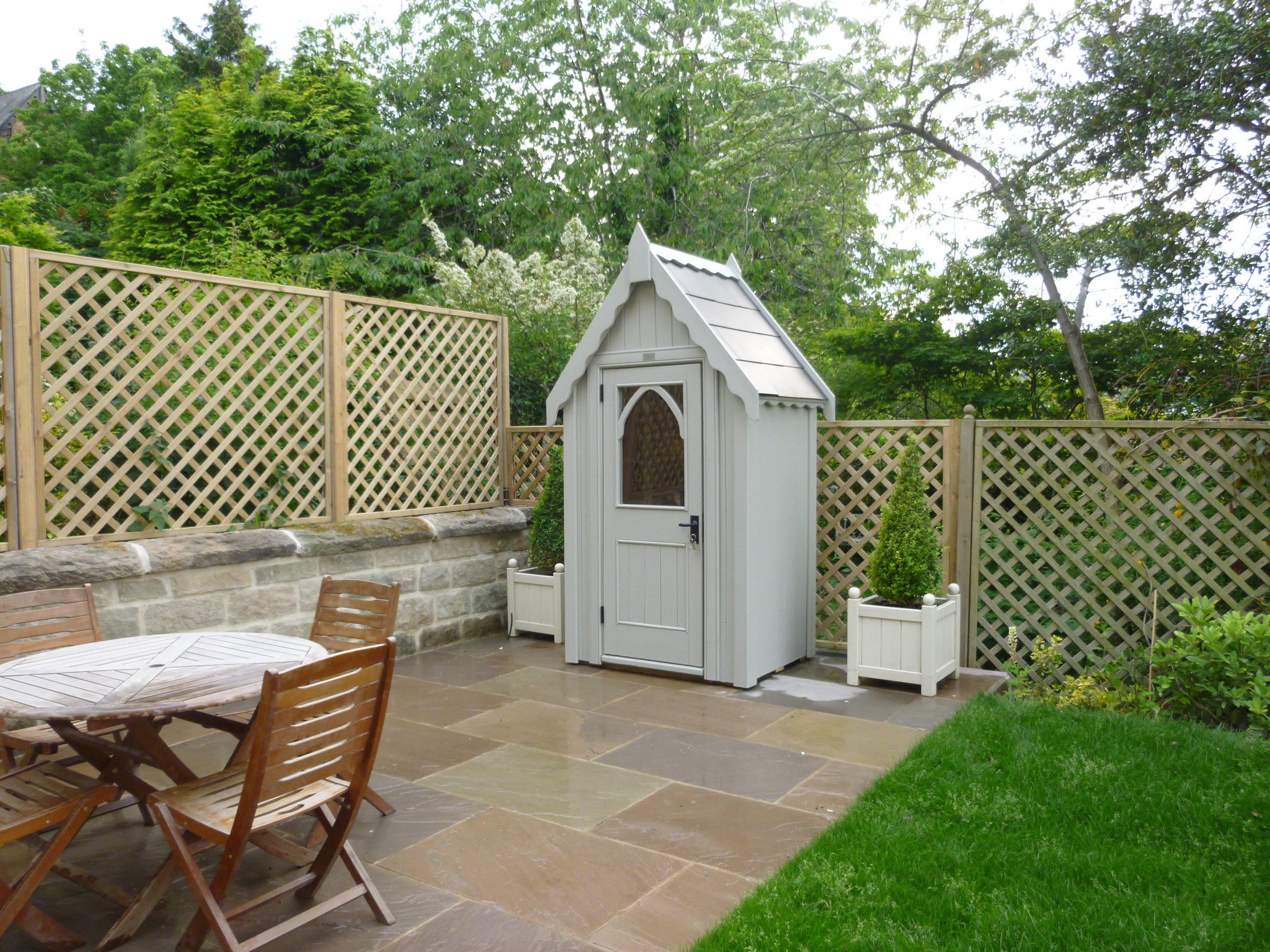 Tiny 'Gothic' styled shed supplied by the Posh Shed Company.