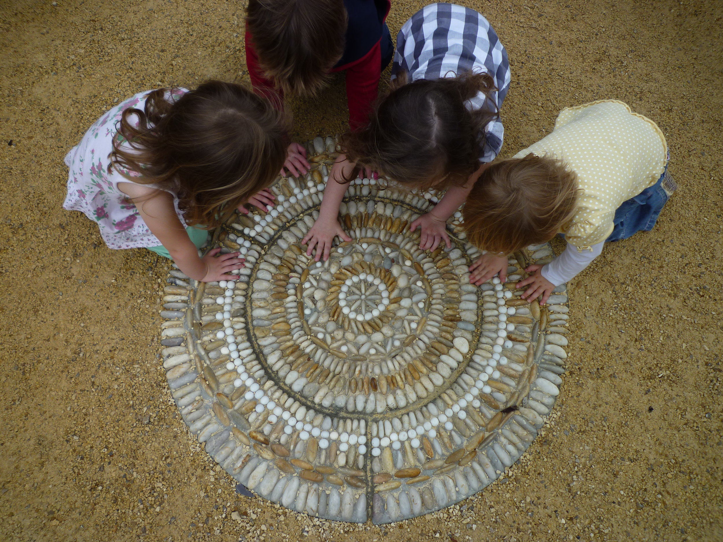 Nursery children exploring the 'Heaven Mosaic' by David James, Olicana Mosaics.