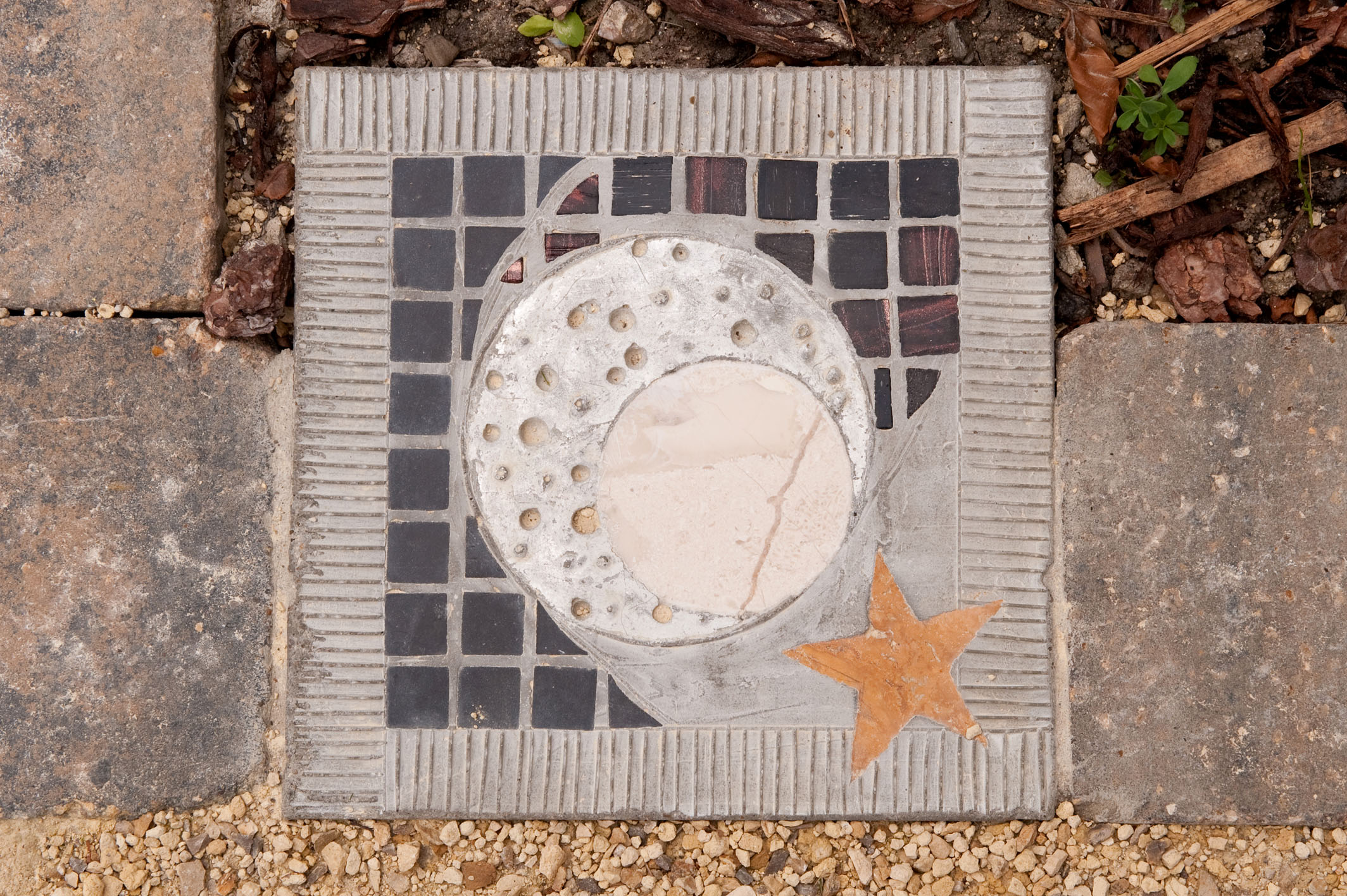 A close up of the Moon and Stars mosaic stepping stone path by David James, Olicana Mosaics.