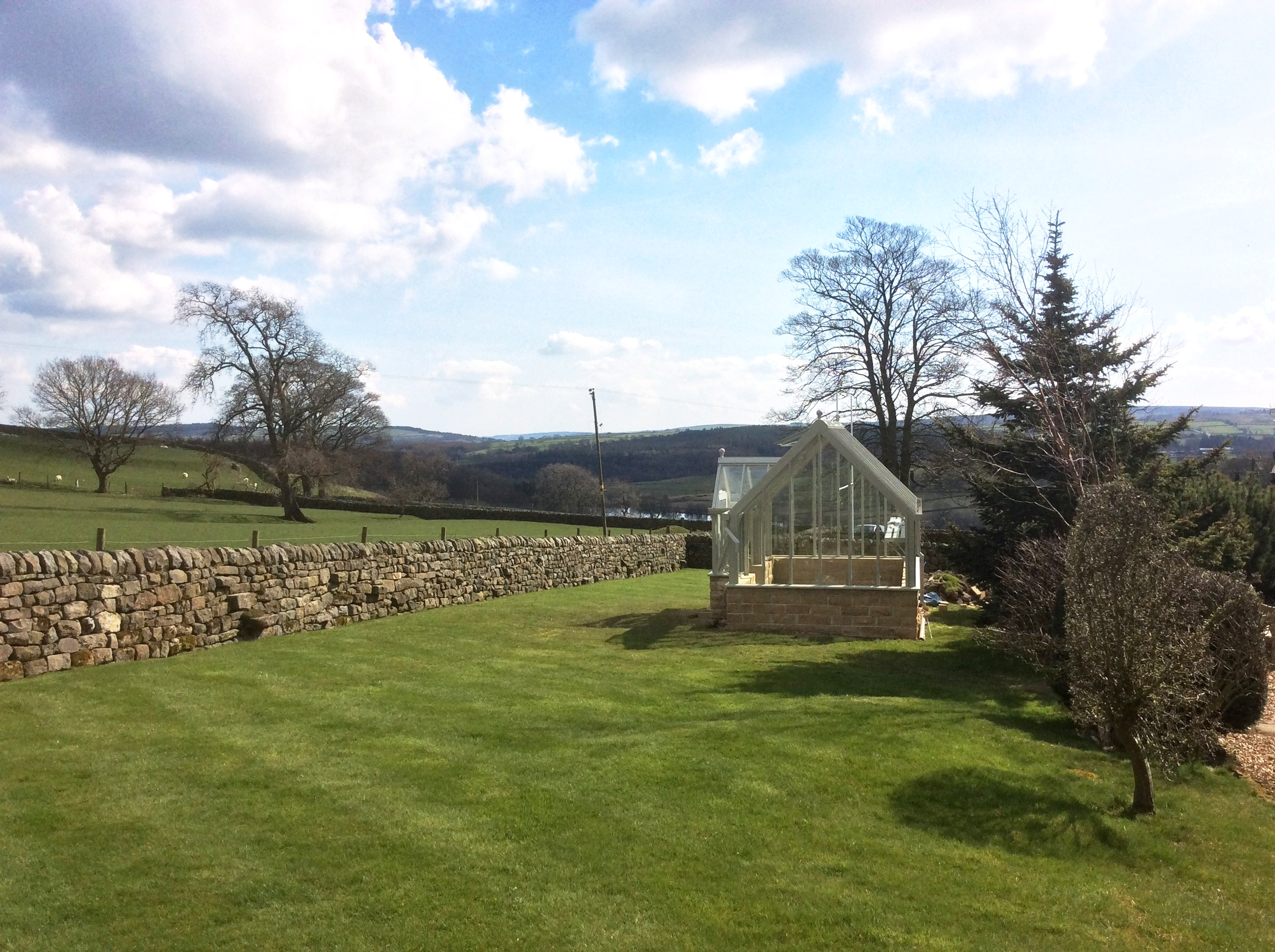 The new greenhouse, recently installed and ready to be linked to the rest of the garden.