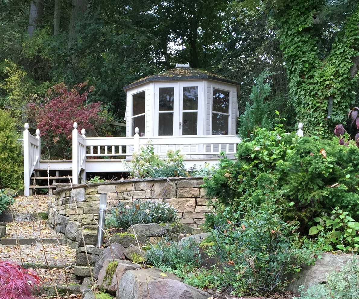 The former pond in front of the summer house was infilled with soil and planted.